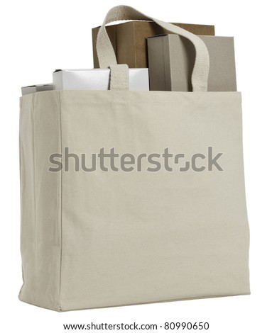 Reusable shopping bag with various plain cardboard boxes.