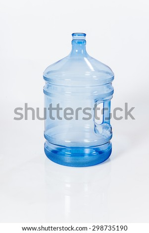 Reusable standard five-halons plastic water bottle for cooler white background - stock photo