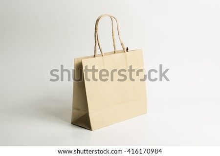reused brown paper bag isolated on white background - stock photo