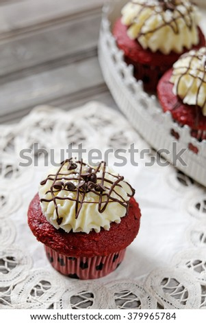 Rev Velvet Cupcakes with cream cheese frosting and chocolate chips - stock photo