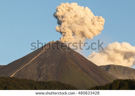 Reventador Volcano erupting in the early morning, August 2016. The mountain is situated in a remote part of the Ecuadorian Amazon surrounded by rainforest.