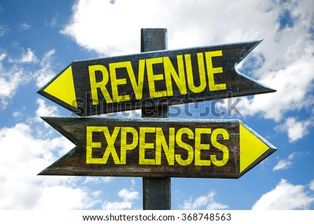 Revenue - Expenses signpost with sky background