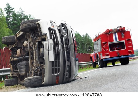 Reversed automobile car laying on country road after accident crash - stock photo