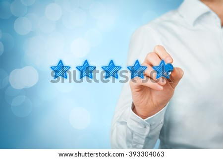 Review, increase rating or ranking, evaluation and classification concept. Businessman draw five yellow star to increase rating of his company. Bokeh in background.