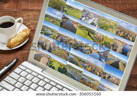 reviewing and editing aerial landscape pictures on laptop -  Ft Collins and northern CO featuring city downtown, residential areas lakes and parks . All screen pictures copyright by the photographer. - stock photo