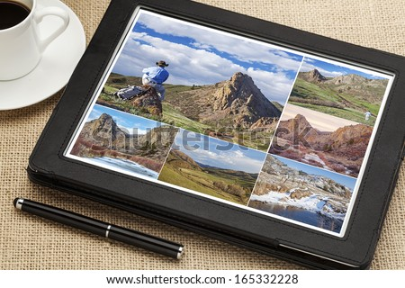 reviewing hiking pictures on a digital tablet, Eagle Nest Open Space in northern Colorado, all displayed pictures copyright by the photographer - stock photo
