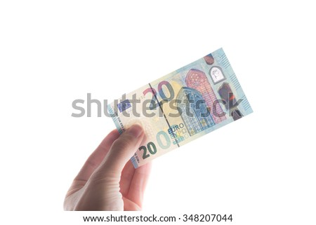 Revised Twenty Euro Note in hand held - revised design - stock photo