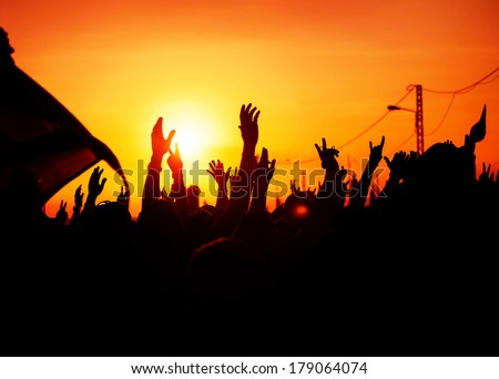 Revolution, people protest against government, man fighting for rights, silhouettes of hands up in the sky, threat of war  - stock photo