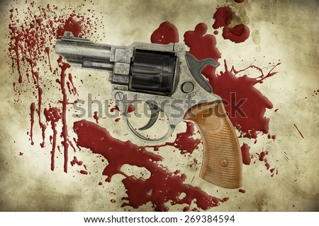 Revolver and blood on grunge background - stock photo