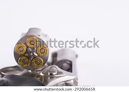 revolver and bullets on white background - stock photo