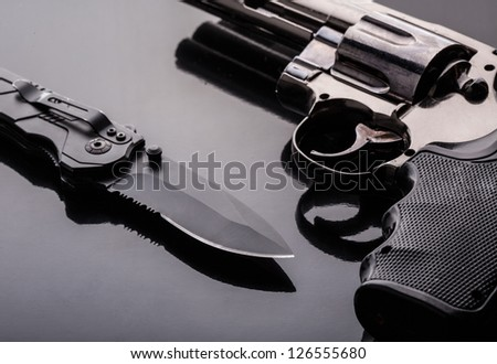 Revolver Gun and tactical knife - stock photo