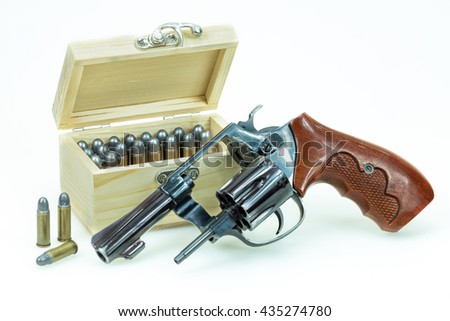 revolver gun with bullets isolated on wooden background.  - stock photo