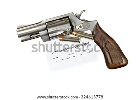 Revolver Gun with Concealed Weapon Permit Isolated on White Background - stock photo