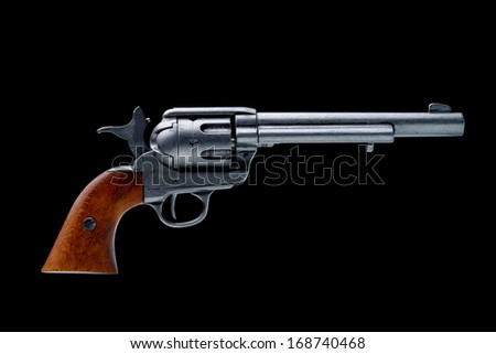 revolver pistol isolated on a black background - stock photo