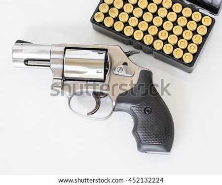 Revolvers gun and ammunition isolated on white background. - stock photo