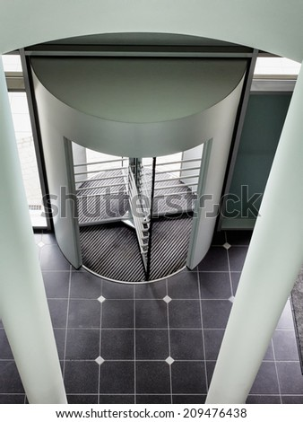 revolving door at an office building - stock photo