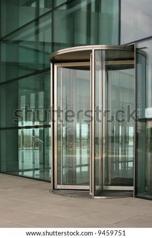 Revolving glass door on a modern corporate building & Rotating Door Stock Images Royalty-Free Images u0026 Vectors ... pezcame.com