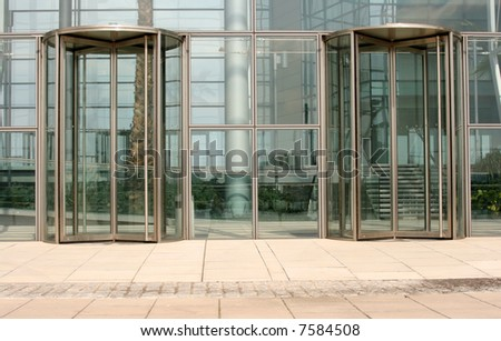 building glass door. revolving glass doors on walled building door e