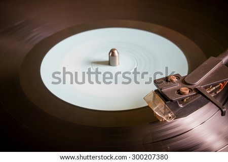 revolving vinyl record on a turntable selective focus - stock photo