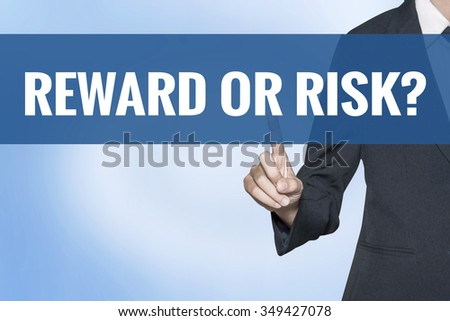 Reward or Risk word on virtual screen touch by business woman blue background - stock photo