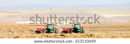 Rexburg, Idaho, USA Oct. 9, 2012- Farmers and field hands use farm machinery in the field harvesting red potatoes.   - stock photo