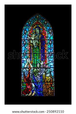 REYKJAVIK, ICELAND - JANUARY 17,  2015: Stained glass depicting the Virgin Mary holding baby Jesus in Hallgrimskirkja Cathedral in Reykjavik