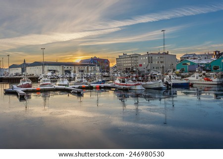 REYKJAVIK, ICELAND - January 14, 2015: Sunrise at the Old Harbor in Reykjavik in Winter.The port of Reykjavik is a hub for fishing boats, tourist cruises, and cargo ships. - stock photo