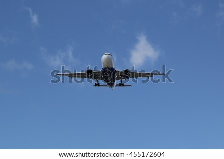 REYKJAVIK, ICELAND - JULY 6, 2016: Atlantic Airways Airbus 319 descending at Reykjavik Airport. Atlantic Airways is the national airline of the Faroe Islands - stock photo