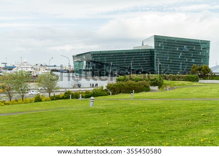 Reykjavik, Iceland, May 2014: An exterior view of the Harpa Concert Hall and Conference Centre - stock photo