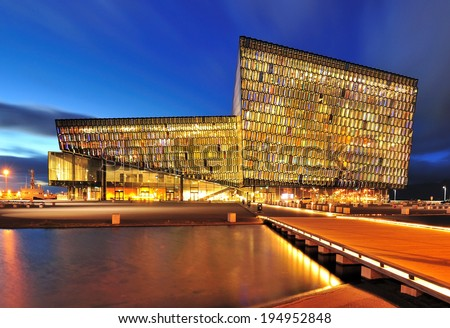 REYKJAVIK, ICELAND - SEPTEMBER 16: Night scene of Harpa Concert Hall in Reykjavik, Iceland on September 16, 2013. The Harpa Concert Hall is the new landmark of the city, build in 2011.  - stock photo