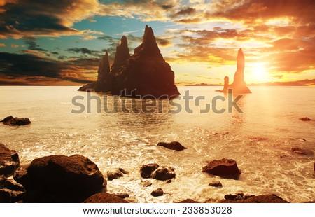 Reynisdrangar rock formations near Vik at sunset, Iceland - stock photo