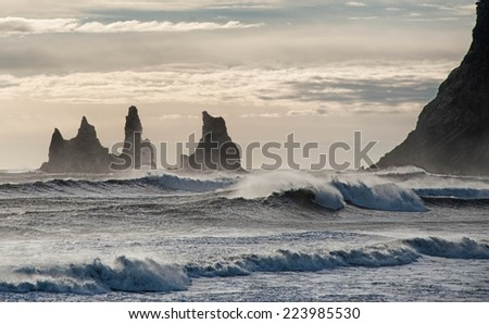 Reynisdrangar Rocks on the black sand beach near Vik village in Iceland - stock photo
