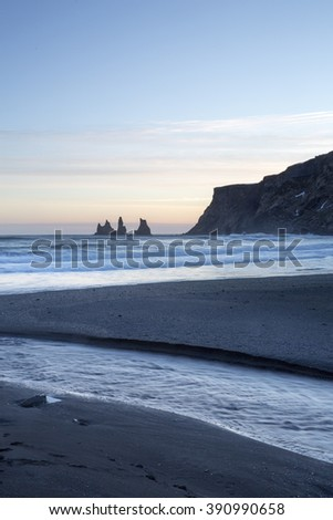 Reynisdrangar sea stacks at sunset, Vik, Iceland, with black sand beach in foreground