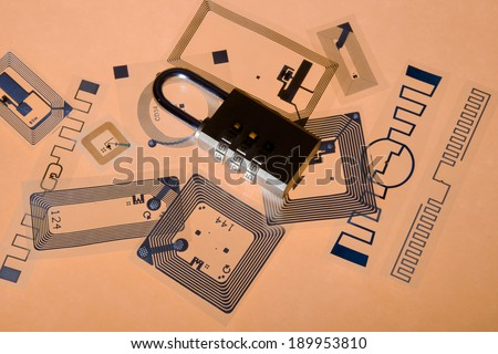 RFID. Cipher lock on Radio Frequency Identification tags, orange background  - stock photo