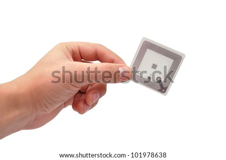 RFID tag in hand  on a white background - stock photo