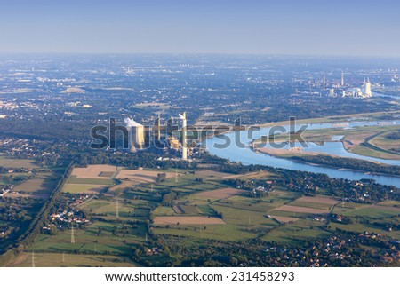 Rhine River bend Orsoy with agricultural, industrial and residential districts in the Lower Rhine Region of Germany - Voerde, North Rhine-Westfalia, Germany, Europe