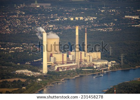 Rhine River with coal-fired Power Station in the Lower Rhine Region of Germany - Voerde, North Rhine-Westfalia, Germany, Europe - stock photo
