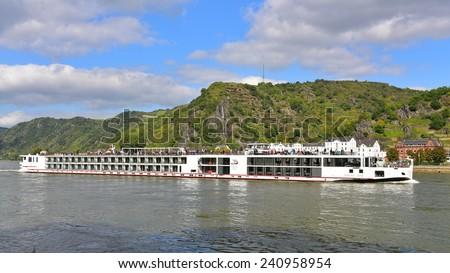 RHINE VALLEY - SEPTEMBER 23: 190-passenger Viking Tor vessel cruising leisurely along Rhine River, taken on September 23, 2014 in Rhine Valley, Germany - stock photo