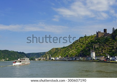 Rhine valley with cruise ship and castle Katz, Germany. Rhine Valley is UNESCO World Heritage Site - stock photo