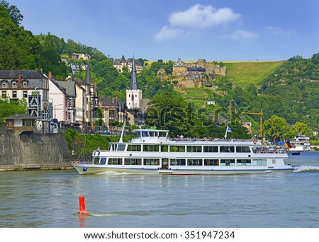 Rhine valley with cruise ship and village of Sankt Goar with Rheinfels Castle, Germany. Rhine Valley is UNESCO World Heritage Site - stock photo