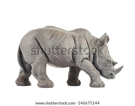 Rhinoceros rhino sculpture made of carved dark gray stone isolated over white background