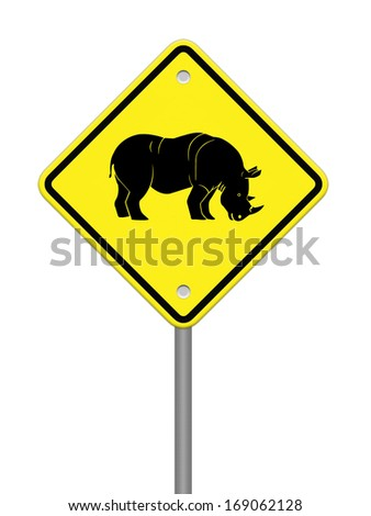 Rhinoceros  warning sign on the road