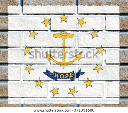 Rhode Island state flag of America on brick wall - stock photo