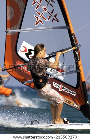 Rhodes, Greece - July 30, 2008: An amateur athlete rides the sea water with his kite-surf during his holiday in Greece. - stock photo