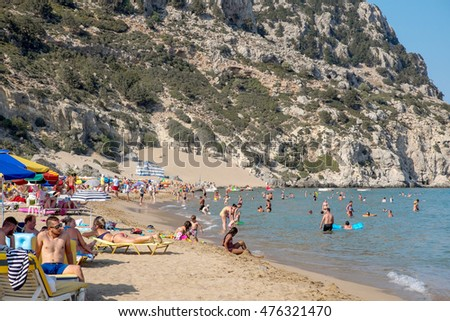 Rhodes, Greece - July 21: Tsambika beach on 21 July, 2016 in Rhodes, Greece. It is one of the most beautiful beaches of Rhodes. A long, broad beach with fine golden sand.