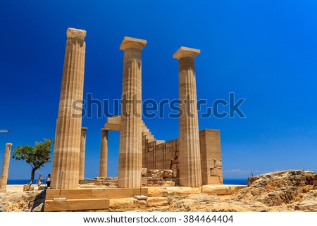RHODES, GREECE - JUNE 14, 2015: Popular tourist attraction the archaeological site of the acropolis of Lindos, a natural citadel on the island of Rhodes. - stock photo