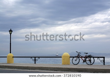 RHODES, GRRECE - NOVEMBER 13, 2010: Bike stands on embankment the Aegean Sea in Rhodes
