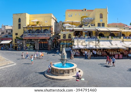 RHODES ISLAND, GREECE - JULY 4: Tourists walking on Hippocrates square in the historic old town of Rhodes, Greece on July 4, 2015. Rhodes is an island in Greece, located in the eastern Aegean Sea - stock photo