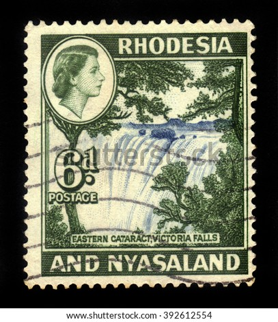 RHODESIA AND NYASALAND - CIRCA 1959: A stamp printed in Federation of Rhodesia and Nyasaland, also known as the Central African Federation (CAF) shows Queen Elizabeth II and Victoria Falls, circa 1959
