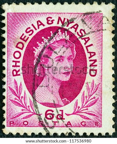RHODESIA AND NYASALAND - CIRCA 1954: A stamp printed in Rhodesia shows Queen Elizabeth II, circa 1954. - stock photo